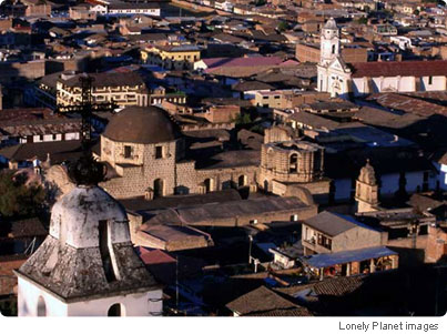Aerial view of city buildings and belltower of Santa Apolina