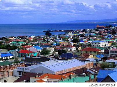 View over the colorful rooftops of Punta Arenas and out to the Magellan Strait